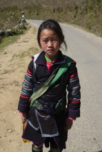 A little Hmong girl walking home to her village in the hills from Sapa.