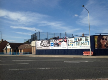 A wall between Protestant and Catholic neighborhoods in East Belfast